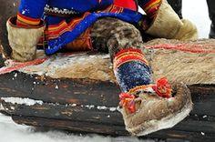 Sami Lapland: A young boy wearing a gákti - native Sámi clothing