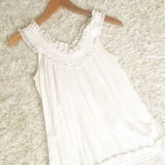 Ruffled top Longer length, off white cotton top. Light weight, perfect for summer. Charlotte Russe Tops