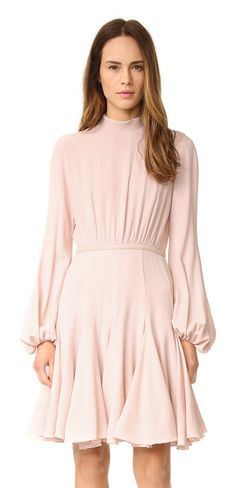 Long sleeve dress by Giambattista Valli. A gored skirt brings flirty swing to this Giambattista Valli mini dress. Ruching trims the crepe waist panel, and the...