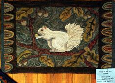 Another 3 in a Row - Cape May hooked rug with Albino Squirrel by Linda Woodbury