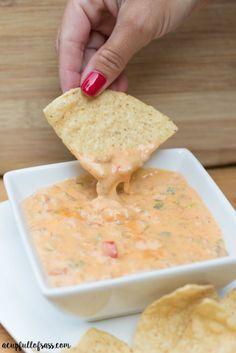 This Crockpot Nacho Dip is perfect for holiday parties and get together with friends and family. It's a loved recipe by all. And it makes a ton!: