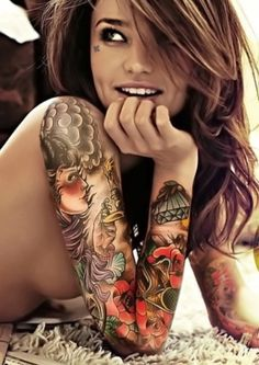Female sleeve tattoo-  I like the balance of color and black and white