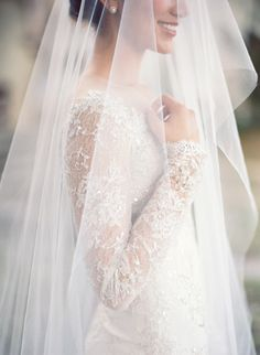 Long lace wedding dress sleeves. Jose Villa | Beautiful and #Classic #wedding #photo.