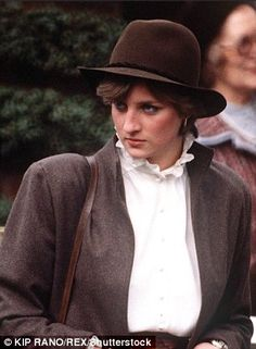 Princess Diana, pictured circa 1980, opts for a dramatic pie-crust collar