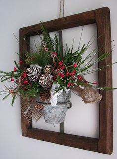 old window, mounted galvanized pail, change the greenery seasonally