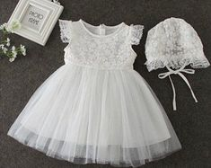 Baptism/Christening gown with immense embroidery and opaque detail. This gown features a lace cap sleeve design. A new heavenly design released just this year, with embroidery throughout and making this item radiant elegance, from top to bottom. Girls Baptism Dress, Girls Smocked Dresses, Girls Lace Dress, Toddler Girl Dresses, Girl Baptism, Dress Lace, Lace Christening Gowns, Baby Girl Christening, Christening Outfit