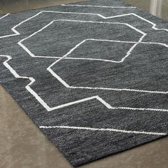 If youve been looking for a unique Moroccan-inspired woven rug then try this beautiful rug. Soft and dense with a subtle geometric pattern, these rugs are made to turn heads. Available in Ivory and Royal Blue or Black and White. Wool/Viscose blend. Imported.