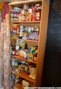 Bookcase transformed into a make-shift pantry - complete with a curtain to draw across it to hide the food away. Would love to do this for our small kitchen and minimal cabinet space but the boys would constantly be in it. Good idea though.