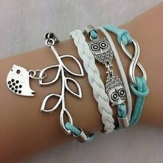 Boho and animal friendly inspired bunch of bracelets and bangles. White and soft teal colour scheme.