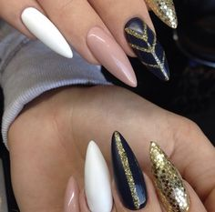 White, cream with black and gold detail nail.  Credit | Instagram @liliyalehetacnd