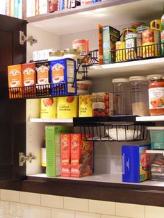 """Cupboard Organization for Cheap! Pantry Inspiration: Wire shelf """"drawer racks"""" for easy access AND better organization! Pull Down Shelf, Pull Down Spice Rack, Spice Racks, Kitchen Cabinet Organization, Kitchen Organization, Kitchen Storage, Organization Ideas, Storage Ideas, Storage Baskets"""