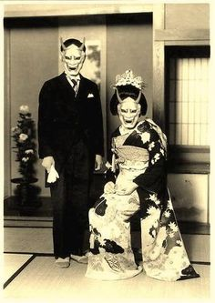 Photographer Unknown. Japanese couple wearing traditional Devil or Oni Masks