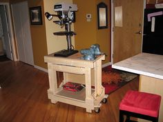 - WOOD Community Plans and Home Des. Workshop Storage, Home Workshop, Shed Storage, Garage Storage, Table Top Drill Press, Drill Press Stand, Woodworking Projects Diy, Diy Wood Projects, Furniture Projects