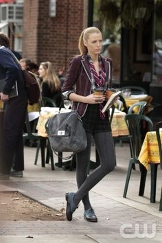 Blake Lively looking super chic and preppy in grey knit tights, shorts, pinstriped blazer and tie.