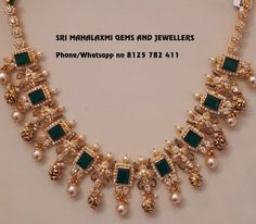 Stunning gold necklace studded with emeralds. Necklace with pearl and gold ball hangigns.