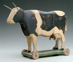 Folk art cow pull toy,