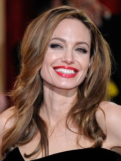 Angelina Jolie's combo of soft, smoky eyes and glossy classic red lips had as much sex appeal as her dress.