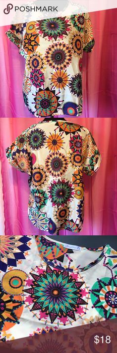 """Lightweight Abstract Top This short sleeve top has a very colorful and quirky pattern. The armpit to armpit measurement is 28"""", with no stretch. Top to bottom it is 24 1/2"""" tall. There is no fabric content listed, but it appears to be a slightly sheer lightweight Polyester. Excellent Used Condition. Bundle to save even more! :) Singwing  Tops Blouses"""