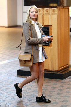 Blonde beauty: The 24-year-old actress kept her revealing look on the smart side of things, adding a classic white shirt and tweed blazer to her tiny bottoms