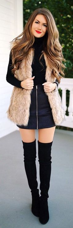 I would never wear this, but I like the lip color with the black, and the faux fur vest #Vests