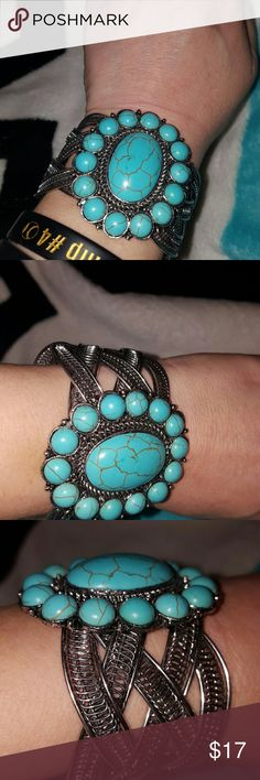Turquoise cuff bracelet Turquoise cuff bracelet worn twice. Bought a a local festival. Adjustable. Goes good with my listing for the squash blossom necklace Jewelry Bracelets