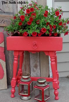 Drawer turned into table. Planter out of dresser drawer. Red dresser drawer repurposed using old table base.