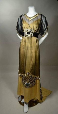Vintage Dresses vintage evening gown from JAMES CAMERON'S TITANIC. Butter yellow silk satin with black marquisette overdress. Yellow, blue and black silk embroidery. An authentic period gown that has been painstakingly restored. Vintage Evening Gowns, Vintage Gowns, Vintage Outfits, 1900s Fashion, Edwardian Fashion, Vintage Fashion, 1920s Fashion Dresses, Fashion Hats, Unique Fashion
