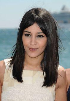 Leila Bekhti's medium length, straight hair with long bangs