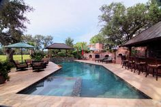 Residential Traditional / Geometric pool, like the inset / integrated spa and copper roofs on the cabana and bar.