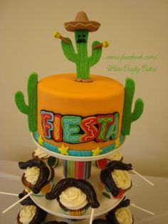 Fiesta - Here is a little cake and cupcakes that I made for my grandson's preschool teachers for their Teacher Appreciation Luncheon. They were having a Fiesta theme. I made chocolate mustache lollipops for on top of the carrot cake cupcakes. It was such a fun theme, and the teachers really enjoyed it