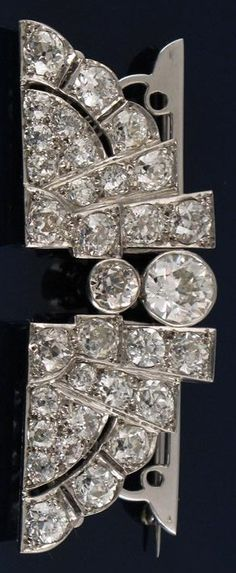 3f2ae2a28833 An Egyptian style Art Deco diamond double clip brooch set in platinum