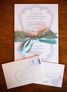 ivory and blue invitation with blue satin bow - real wedding photo by Los Angeles photographer Jay Lawrence Goldman