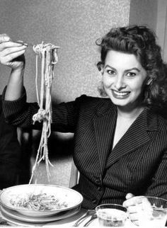 Sophia Loren eating Pasta while on Vacation on the Mediterranean