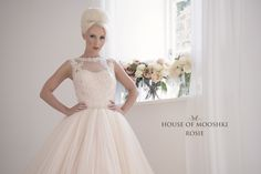 Blush crystal pleated tulle tea length wedding dress.  Blush bodice overlaid in hand dyed guipure lace with sleeveless illusion neckline  www.houseofmooshki.com/our-dresses/rosie