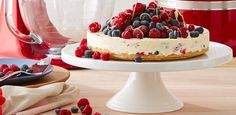 Indulge in this heavenly white chocolate berry cheesecake - filled with everything your heart desires. This delightful cake is the perfect dessert for any occasion!