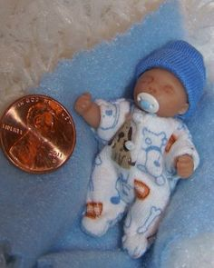 Dollhouse Miniature Baby.  Once I get my nursery done I'm getting me one of these cute little babies!