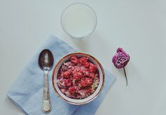 Breakfast Blog - Morning Diaries - Pink lingonberry oatmeal with warm raspberries and lemon cest, a glass of milk.