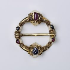 Ring brooch - 1250-1300. Gold, cast and chased; Garnets, sapphires. France (possibly, made) / England (possibly, made)