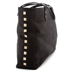Bleeker Street studded leather tote. We would be attached at the shoulder all year round.