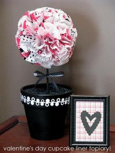 cupcake wrapper topiary and you don't have to buy those styrofoam balls! Just use newspaper and packing tape. Nice!