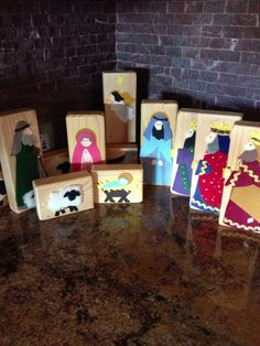 Manger craft made with 2x4 sanded wood blocks and felt for characters