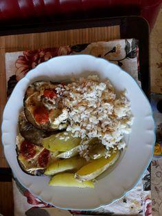 Beringela gratinada com azeite camenberg ervas e tomatinho cereja batata rustica e arroz branco.