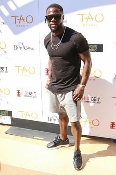 cfeb5c2f46e Kevin Hart Wears Fear Of God Shorts and Nike Sneakers at HartBeat Pool  Party in Las