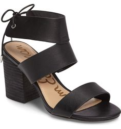 A supersized, chunky stacked heel elevates this breezy faux-leather sandal styled with a back-tie ankle strap for a standout warm-weather look.