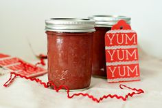 two jars of rhubarb butter with a holiday gift tag and ribbon