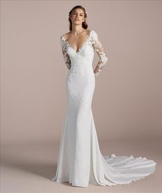 Fitted wedding dress - This beautiful gown is a homage to the female figure Sleek and figure hugging with lace long sleeves RaffaeleCiuca LaSposa WeddingDress Bride Wedding Dresses Tight Fitted, Sleek Wedding Dress, Fit And Flare Wedding Dress, Wedding Dress Sleeves, Long Wedding Dresses, Long Sleeve Wedding, Perfect Wedding Dress, Tight Dresses, Bridal Dresses