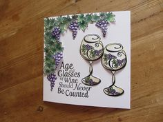 Suelesley's Craft RoomHere's a card I made  using two fabulous sets from Honeydoo.  One set is sentiments which compliment the other set which is a wine glass, bottle, bunches of grapes and a leaf.  I stamped and coloured lots of leaves and bunches of grapes before cutting them all out - time consuming but actually quite therapeutic.  I then stuck all the leaves on individually creating a vineyard look.  I also cut out the glasses and added some dimension with some foam pads.