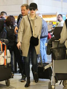 Flying under the radar! Emma Stonewent undercover on Monday as she departed LAX airport and headed for Paris