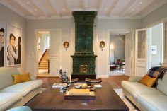 Lovely tile fronted stove and mix of contemporary art and furnishings in house near Djursholm, Sweden. seventeendoors