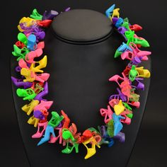 Barbie shoe necklace--i could see this as a bracelet, but where would you get all the Barbie shoes???